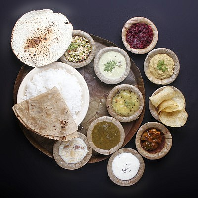 indian-food-with-chapatti-rice-curries-vegetables-papad-pickle-payasam-f4-400x400-1433934381